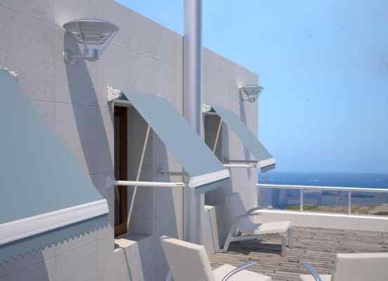 Toldo sistema brazo punto recto modelo Indico para protección solar de ventanas y sistema de brazos antiviento. Para mayor seguridad apertura y cierre mediante manivela o motor.